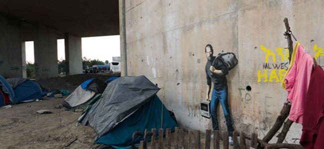 Banksy bu kez Suriyeli mülteci Stve Jobs'u çizdi